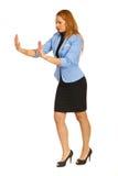 Business woman pushing something Royalty Free Stock Image
