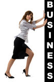 Business woman pushing something Stock Image