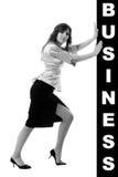 Business woman pushing something Stock Image