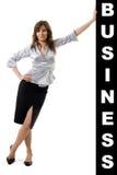 Business woman pushing something Royalty Free Stock Photos