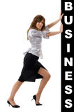 Business woman pushing something Royalty Free Stock Photography