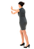 Business woman pushing something Royalty Free Stock Photo