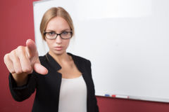 Business woman pushing on a touch screen interface Royalty Free Stock Photo