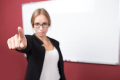 Business woman pushing on a touch screen interface Stock Image