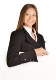 Business woman put her hand on a blank white board. Royalty Free Stock Photos