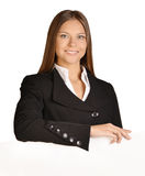 Business woman put her hand on a blank white board. Royalty Free Stock Photography