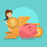 Business woman putting coin in piggy bank. Smiling business woman putting money in a big pink piggy bank. Young caucasian business woman saving her money in Royalty Free Stock Photos