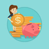Business woman putting coin in piggy bank. Stock Photo
