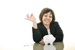 Business woman putting coins money in piggy bank Stock Images