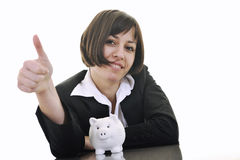 Business woman putting coins money in piggy bank Stock Photography