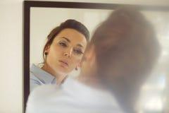 Business woman putting makeup Stock Image