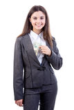 Business woman putting/ taking  dollars Stock Photo