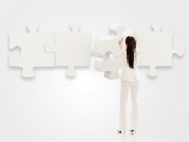 Business woman with a puzzle Stock Photography