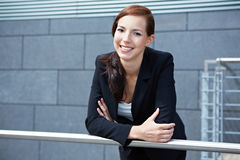 Business woman on railing Royalty Free Stock Photos