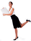 Business Woman raise his left leg with laptop Royalty Free Stock Images