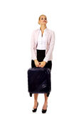 Business woman raising her suitcase Stock Photography