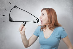 Business woman ranting in megaphone. Young angry business woman ranting in a megaphone Stock Image