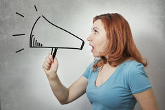 Business woman ranting in megaphone. Young angry business woman ranting in a megaphone Stock Photo