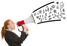 Business woman ranting in megaphone. Young angry business woman ranting in a megaphone with symbols coming out Royalty Free Stock Photography