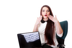 Business woman reading bad news at laptop Royalty Free Stock Image