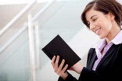 Business woman reading a book Royalty Free Stock Photo
