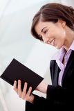 Business woman reading a book Stock Image