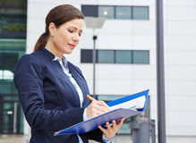 Business woman reading contract Stock Photo