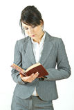 Business woman reading diary Royalty Free Stock Images