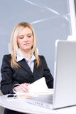 Business woman reading documents Stock Images
