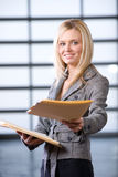 Business woman reading documents Royalty Free Stock Photography