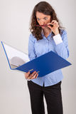 The business woman is reading in a file Royalty Free Stock Photography