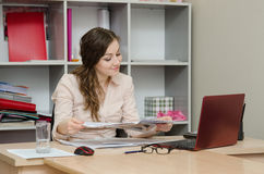 Business woman reading a magazine in the office Stock Photos