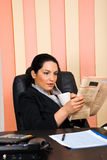 Business woman reading news Royalty Free Stock Image