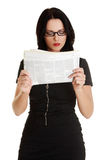 Business woman reading a newspaper Stock Photo