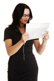 Business woman reading a newspaper Royalty Free Stock Images