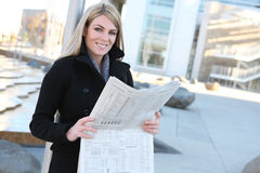Business Woman Reading Newspaper Stock Photography