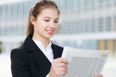 Business woman reading a newspaper Stock Photography