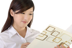 Business woman reading paper Royalty Free Stock Image