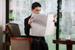 Business woman reading paper Stock Images