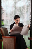 Business woman reading paper Royalty Free Stock Photo