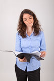 The business woman is reading in a record Royalty Free Stock Photo