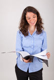 The business woman is reading in a record Royalty Free Stock Photos