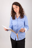 The business woman is reading in a record Royalty Free Stock Images