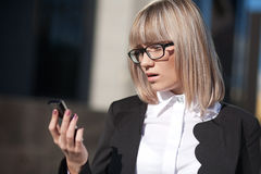 Business woman reading a text message Stock Image