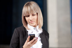 Business woman reading a text message Stock Photography