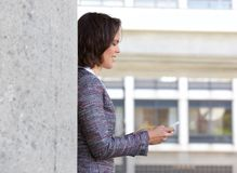 Business woman reading text message on cell phone Stock Photos
