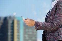 Business woman reading text message in the city Stock Images