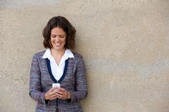 Business woman reading text message on mobile phone Stock Photo