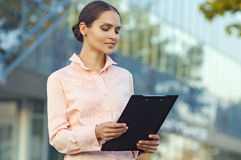 Business woman reads the document royalty free stock photo