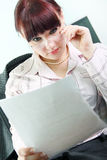 Business woman reads documents Royalty Free Stock Photo